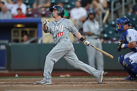 Reno Aces Jake Elmore #10 swings the bat during the game against the Omaha Storm Chasers at Werner Park on August 3, 2012 in Omaha, Nebraska.(Dennis Hubbard/Four Seam Images)