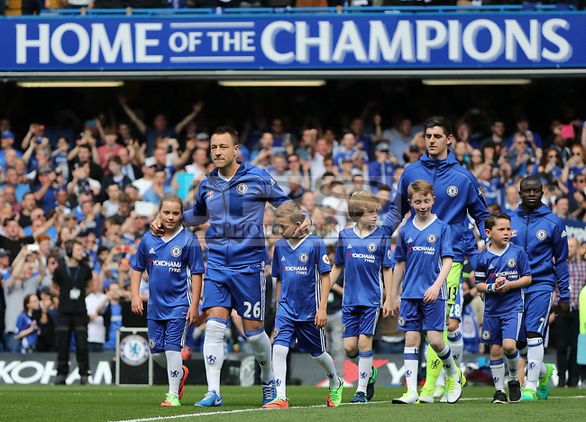 John Terry (C) of Chelsea walks the Chelsea team onto the pitch before the Premier League match between Chelsea v Sunderland, Stamford Bridge, London on 21st May 2017