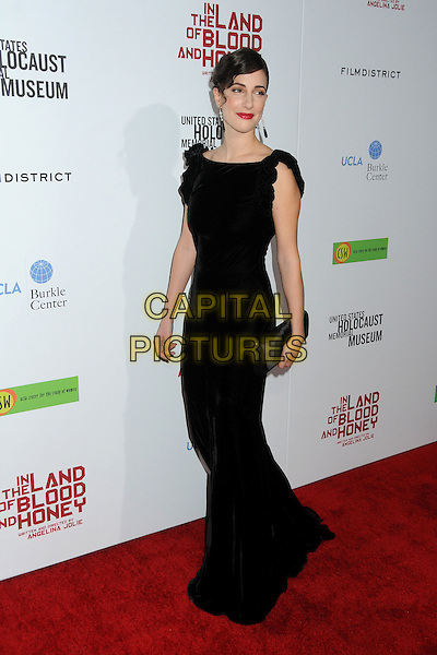 Zana Marjanovic.'In The Land Of Blood And Honey' Los Angeles Premiere held at The Arclight Theatre, Hollywood, California, USA..8th December 2011.full length black dress clutch bag.CAP/ADM/BP.©Byron Purvis/AdMedia/Capital Pictures.