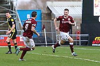 James Collins of Northampton Town (right) celebrates scoring the opening goal against Morecambe during the Sky Bet League 2 match between Northampton Town and Morecambe at Sixfields Stadium, Northampton, England on 23 January 2016. Photo by David Horn / PRiME Media Images.