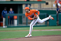 Starting pitcher Brooks Crawford (19) of the Clemson Tigers delivers a pitch in a game against the South Alabama Jaguars on Opening Day, Friday, February 15, 2019, at Doug Kingsmore Stadium in Clemson, South Carolina. Clemson won, 6-2. (Tom Priddy/Four Seam Images)