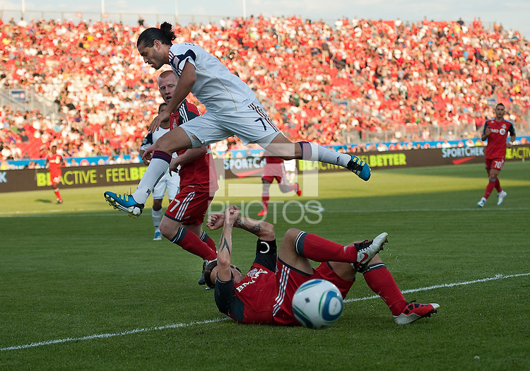 13 August 2011: Real Salt Lake forward Fabian Espindola #7 leaps over Toronto FC midfielder Torsten Frings #22 during a game between Real Salt Lake and Toronto FC at BMO Field in Toronto..Toronto FC won 1-0.