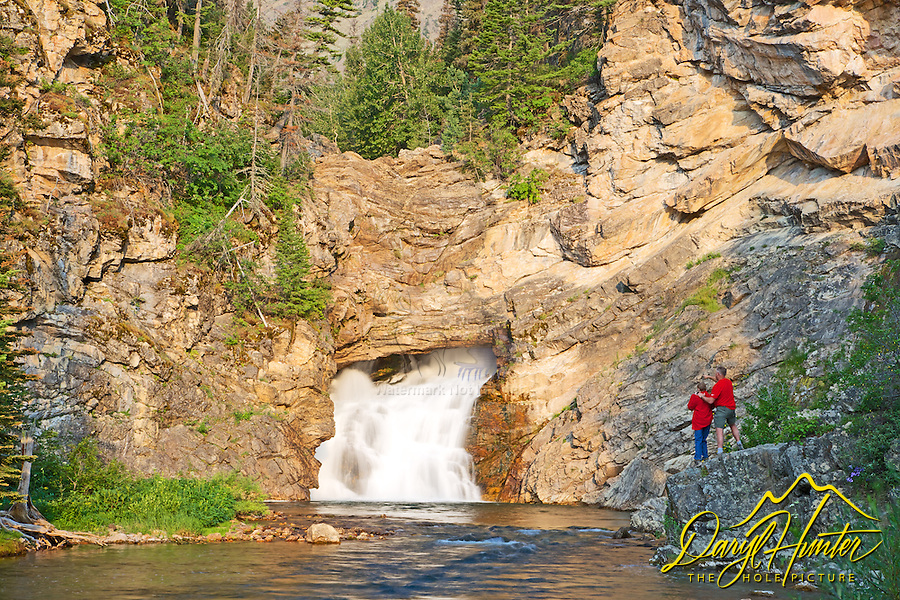 Father and son at Running Eagle Falls in Glacier National Park