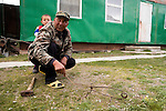 Ranger Ulan Toktosunov and his son with snare trap, Besh Moinok, Tien Shan Mountains, eastern Kyrgyzstan