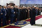 Palestinian President Mahmoud Abbas and his Prime Minister Rami Hamdallah perform Eid al-Adha prayers, in the West Bank city of Ramallah on September 1, 2017. Photo by Osama Falah
