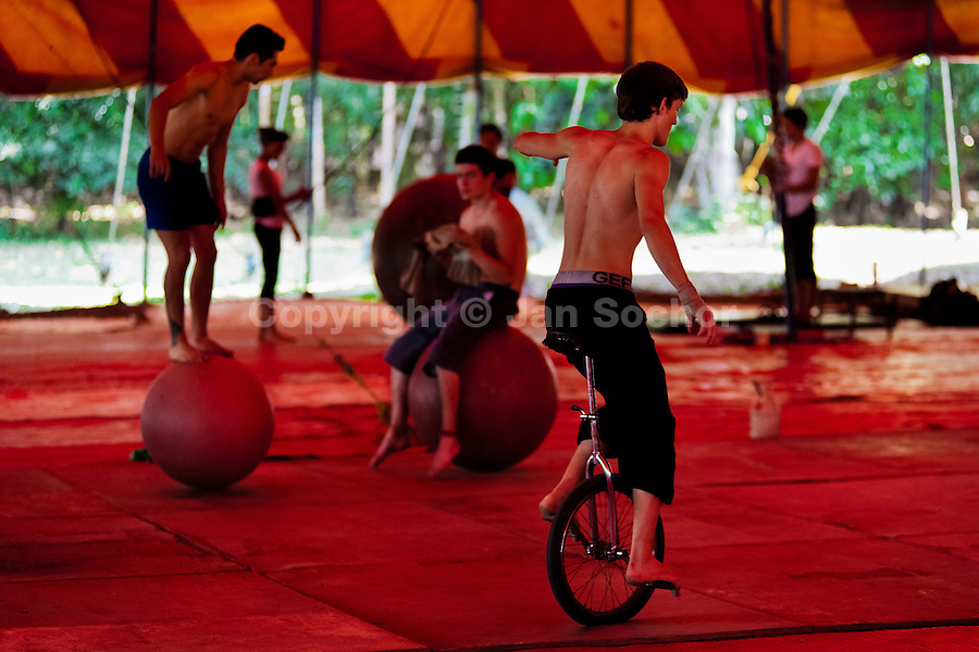 "A student performs on a monocycle during the lessons in the circus school Circo para Todos in Cali, Colombia, 29 May 2012. Circo Para Todos (""Circus for All""), founded by Felicity Simpson, a former British circus performer, is the first professional circus school in the world specifically dedicated to disfavoured kids and talented street children. Students are trained in a range of circus art skills including acrobatics, balancing, juggling, stilt walking or unicyling. After finishing the four-year course, graduates may find jobs in circuses in the world or in the cruise ships."