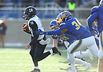 BROOKINGS, SD - DECEMBER 9: Trevor Knight #18 from the University of New Hampshire slips past the grasp of Austin Smenda #34 from South Dakota State University during their FCS quarterfinal game Saturday afternoon at Dana J. Dykhouse Stadium in Brookings, SD. (Photo by Dave Eggen/Inertia)