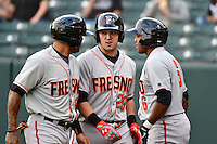 Adam Duvall (29) of the Fresno Grizzlies talks to his team mates after hitting a home run against the Salt Lake Bees at Smith's Ballpark on April 9, 2014 in Salt Lake City, Utah.  (Stephen Smith/Four Seam Images)