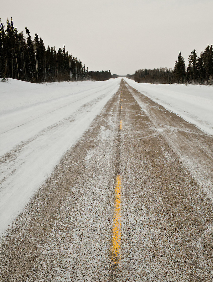 The highway between Enterprise and Yellowknife is partially snow-covered.
