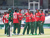 The players look to the big screen for the outcome of the review against Babar Azam (Pakistan) during Pakistan vs Bangladesh, ICC World Cup Cricket at Lord's Cricket Ground on 5th July 2019
