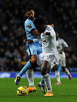 Picture: Andrew Roe/AHPIX LTD, Football, Barclays Premier League, Manchester City v Swansea City, 22/11/14, Etihad Stadium, K.O 3pm<br /> <br /> City's Gael Clichy battles with Swansea's Wilfried Bony<br /> <br /> Andrew Roe>>>>>>>07826527594