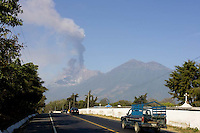 Volcano Fuego shoots smoke and debris up to 500 meters, seen from near Ciudad Vieja, Guatemala. An orange alert has been issued to the 31,000 people that live in communities close to the volcano.