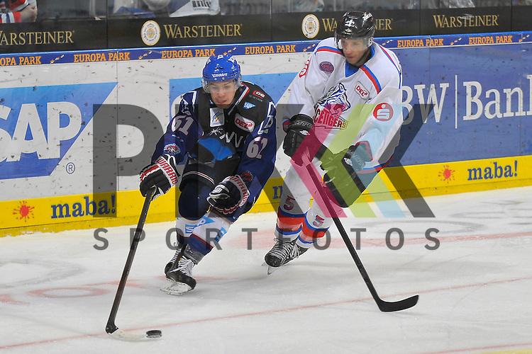 Mannheims Mirko Hoefflin (Nr.61) gegen Nuernbergs Rob Leask (Nr.5)  beim Spiel in der DEL, Adler Mannheim - Nuernberg Ice Tigers.<br /> <br /> Foto &copy; Ice-Hockey-Picture-24 *** Foto ist honorarpflichtig! *** Auf Anfrage in hoeherer Qualitaet/Aufloesung. Belegexemplar erbeten. Veroeffentlichung ausschliesslich fuer journalistisch-publizistische Zwecke. For editorial use only.