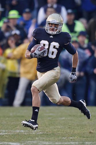 Notre Dame wide receiver Bennett Jackson (#86) returns kick during NCAA football game between Utah and Notre Dame.  The Notre Dame Fighting Irish defeated the Utah Utes 28-3 in game at Notre Dame Stadium in South Bend, Indiana.