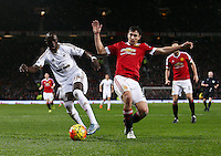 Madou Barrow of Swansea City and Matteo Darmian of Manchester United during the Barclays Premier League match between Manchester United and Swansea City played at Old Trafford, Manchester on January 2nd 2016