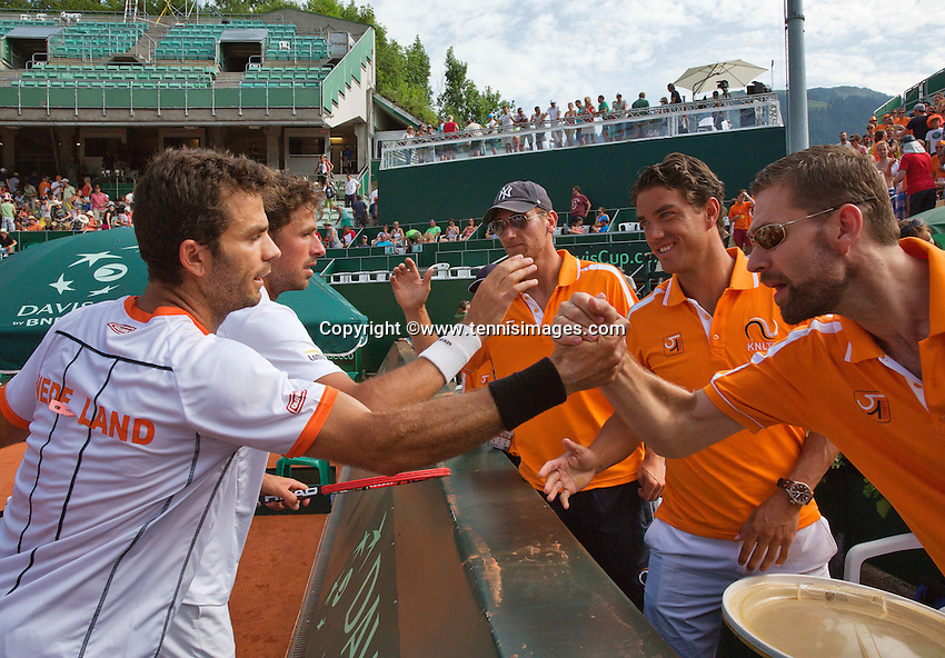 Austria, Kitzbühel, Juli 18, 2015, Tennis,  Davis Cup, Third match doubles: Olivier Marach/Jurgen Meltzer (AUT) vs Jean-Julien Rojer/ Robin Haase (NED), pictured: Jean-Julien Rojer/ Robin Haase celebrating their win with their team members<br /> Photo: Tennisimages/Henk Koster