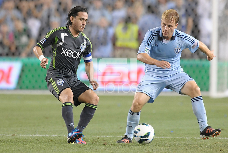 Mauro Rosales (10) midfield Seattle Sounders , Seth Sinovic (16) defender Sporting KC..Sporting Kansas City defeated Seattle Sounders on penalty kicks, after a 1-1 tied game to win the Lamar Hunt Open Cup at LIVESTRONG Sporting Park, Kansas City, Kansas..