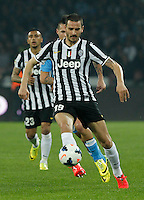 Leonardo Bonucci    in action during the Italian Serie A soccer match between SSC Napoli and Juventus FC   at San Paolo stadium in Naples, March 30 , 2014