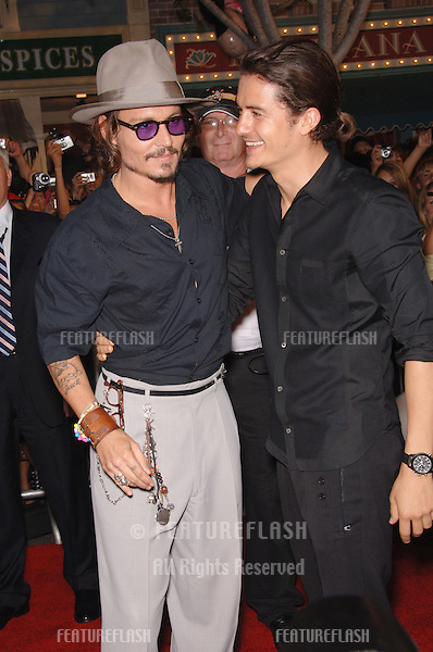 """Actors JOHNNY DEPP (left) & ORLANDO BLOOM at the world premiere of their new movie """"Pirates of the Caribbean: Dead Man's Chest"""" at Disneyland, CA..June 24, 2006  Anaheim, CA.© 2006 Paul Smith / Featureflash"""