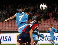 Edinson Cavani shoot to head past Genoa's  Emiliano Moretti during their Italian Serie A soccer match at the San Paolo  stadium in Naples April 7, 2013