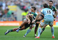 Manu Tuilagi is tackled in possession. Aviva Premiership Final, between Leicester Tigers and Northampton Saints on May 25, 2013 at Twickenham Stadium in London, England. Photo by: Patrick Khachfe / Onside Images
