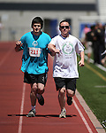 Volunteer Joseph Turner leads Robert Morales, of Lassen, through the 1500-meter race at the Special Olympics Nevada 2013 Summer Games in Reno, Nev., on Saturday, June 1, 2013. <br /> Photo by Cathleen Allison