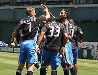 Ronnie O'Brien (31) Scott Sealy (33) and other San Jose players celebrate with Arturo Alavarez after his goal in the 8th minute. San Jose Earthquakes defeated LA Galaxy 3-2. August 3, 2008, McAfee Coliseum, Oakland, CA.