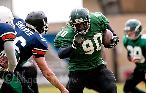09 MAY 2010 - NORTHAMPTON, GBR - Stirling Clansmen (green and black) vs Greenwich Mariners (blue and black) - British Universities American Football Challenge Trophy Final .(PHOTO (C) NIGEL FARROW)