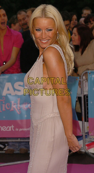 "DENISE VAN OUTEN.Arrivals at ASDA's ""Tickled Pink"" charity concert held at The Royal Albert Hall,.London, 18th September 2005,.half length dress pink chiffon over shoulder.Ref: CAN.www.capitalpictures.com.sales@capitalpictures.com.©Capital Pictures"