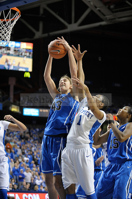 Duke player Allison Vernerey rebounds over University of Kentucky player A'dia Mathies during the second half of the University of Kentucky Women's Basketball game against Duke at Rupp Arena in Lexington, Ky., on 12/8/11. Uk won the game 72-65. Photo by Mike Weaver | Staff