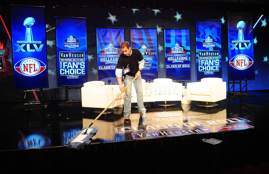 February 5, 2011; Dallas, TX, USA; A NFL Network worker cleans the stage before a press conference naming the NFL Hall of Fame class of 2011 at the Super Bowl XLV media center. Mandatory Credit: Mark J. Rebilas-
