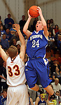 SIOUX FALLS, SD - FEBRUARY 26:  Connor Nagel #24 from O'Gorman shoots over Josh Kirkwold #33 from Roosevelt in the second half of their District 1AA game Tuesday night at Roosevelt. (Photo by Dave Eggen/Inertia)