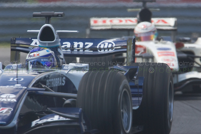 MONTREAL - JUNE 24: Nico Rosberg of Williams leads Jensen Button of Honday Racing through the Senna complex of turns 1 and 2 during Saturday qualifying for the Canadian F1 Grand Prix at the Circuit Gilles-Villeneuve June 24, 2006 in Montreal, Canada.