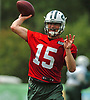 Josh McCown #15, New York Jets quarterback, throws a pass during the first team practice of training camp at the Atlantic Health Jets Training Center in Florham Park, NJ on Saturday, July 29, 2017.