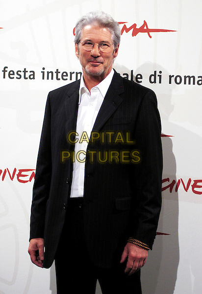 "RICHARD GERE.Poses at a photocall for his new movie ""The Hoax"".on the third day of the Rome Film Festival, Rome, Italy,.October 15th 2006..half length glasses suit jacket.Ref: CAV.www.capitalpictures.com.sales@capitalpictures.com.©Luca Cavallari/Capital Pictures."