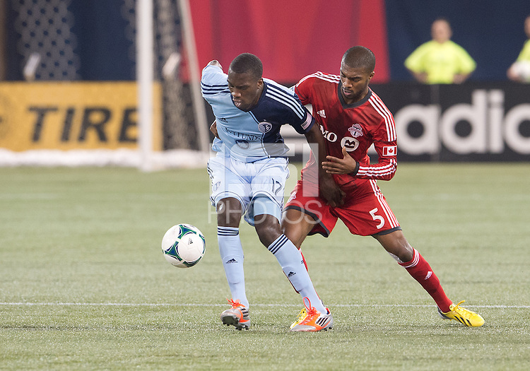 09 March 2013: Toronto FC defender Ashtone Morgan #5 and Sporting KC forward C.J. Sapong #17 in action during an MLS game between Sporting Kansas City and Toronto FC at The Rogers Centre in Toronto, Ontario Canada..Toronto FC won 2-1.