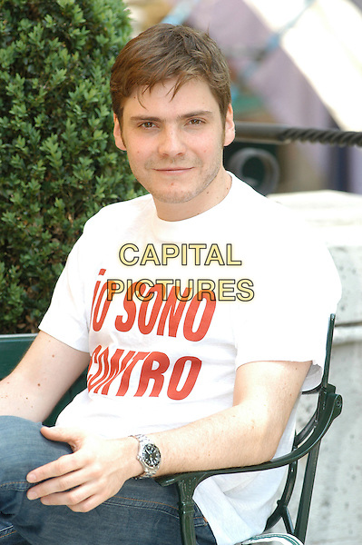 "DANIEL BRUL .Photocall for the film ""Salvador (Puig Antich)"" in Rome, Italy..April 12th, 2007.half length sitting white top .CAP/CAV.©Luca Cavallari/Capital Pictures"