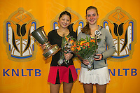 Rotterdam, The Netherlands, 15.03.2014. NOJK 14 and 18 years ,National Indoor Juniors Championships of 2014, Trophy giving on court, winner  girls 18 years Arianne Hartono(L) and runner up Inger van Dijkman.<br /> Photo:Tennisimages/Henk Koster
