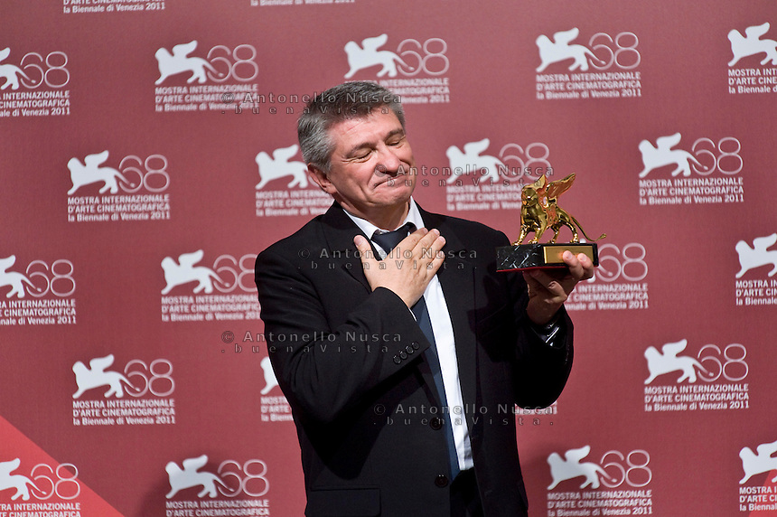 Director Aleksandr Sokurov of 'Faust' poses with the Golden Lion for best film during the Award Winners' Photocall during the 68th Venice International Film Festival