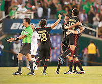 PASADENA, CA – June 25, 2011: Mexico players celebrating their win  during the Gold Cup Final match between USA and Mexico at the Rose Bowl in Pasadena, California. Final score USA 2 and Mexico 4.