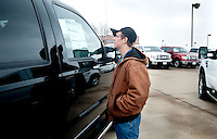 Sam Bartlett (cq) checks out a new F250 Ford truck at Bankston Ford in Frisco, Texas, Thursday, Jan., 28, 2009. Ford reported gains in earnings for the first time in four years...PHOTOS/ Matt Nager