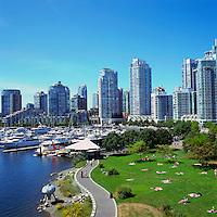 Vancouver, BC, British Columbia, Canada - Yaletown Highrise Buildings overlook Sunbathers at False Creek