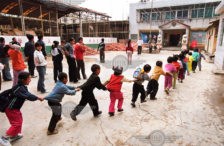 Children line up to enter their classroom in the schoolyard of a school for children of migrant workers.