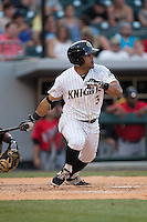 Micah Johnson (3) of the Charlotte Knights follows through on his swing against the Indianapolis Indians at BB&T BallPark on June 20, 2015 in Charlotte, North Carolina.  The Knights defeated the Indians 6-5 in 12 innings.  (Brian Westerholt/Four Seam Images)