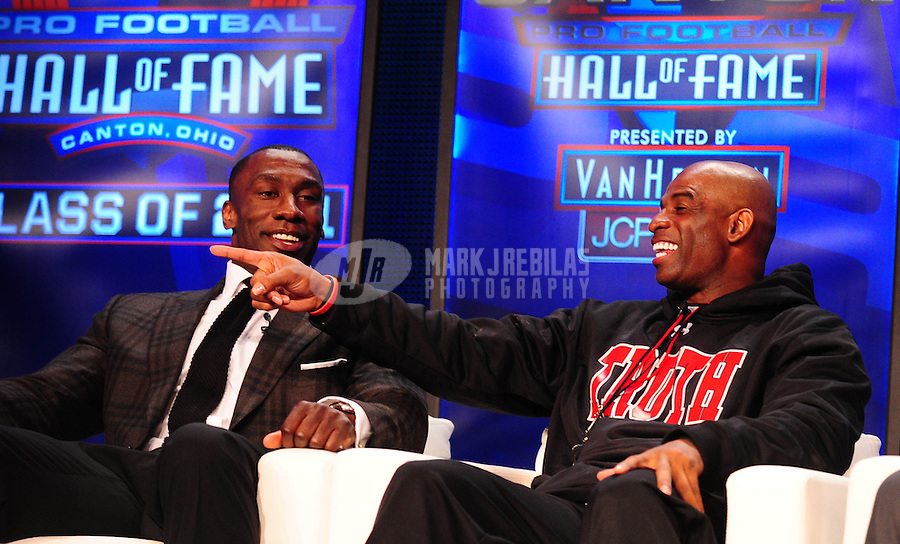 February 5, 2011; Dallas, TX, USA; Deion Sanders (right) talks as Shannon Sharpe (left) looks on during a press conference after being named into the NFL Hall of Fame class of 2011 at the Super Bowl XLV media center. Mandatory Credit: Mark J. Rebilas-
