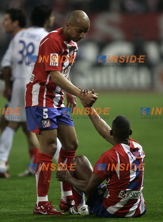 Atletico de Madrid's Peter Luccin (l) and Luis Perea (r) during  the Spanish League match between Atletico de Madrid and Real Madrid at Vicente Calderon Stadium in Madrid, Saturday February 24 2007. (INSIDE/ALTERPHOTOS/B.echavarri).