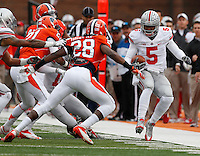 Ohio State Buckeyes quarterback Braxton Miller (5) tiptoes along the sideline while chased by Illinois Fighting Illini defensive back Jaylen Dunlap (28) during Saturday's NCAA Division I football game at Memorial Stadium in Champaign, Il., on November 16, 2013. Ohio State won the game 60-35. (Barbara J. Perenic/The Columbus Dispatch)