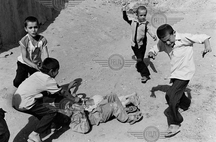 Boys fight in the area above the Babar Shah Gardens.