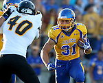 BROOKINGS, SD - SEPTEMBER 20:  Zach Zenner #31 from South Dakota State looks for room around Matt Gasper #40 from Wisconsin-Oshkosh in the first half of their game Saturday at Coughlin Alumni Stadium in Brookings. (Photo/Dave Eggen/Inertia)