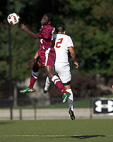 Harvard University defender/forward Pascal Mensah (23) battles for head ball. Boston College defeated Harvard University, 2-0, at Newton Campus Field, October 11, 2011.